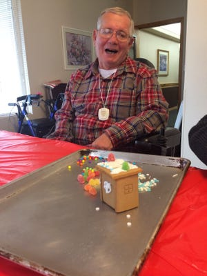 Tom Perfili sits back to look at his gingerbread house on Dec. 9 at Ridgeview Gardens Assisted Living Center in St. George.