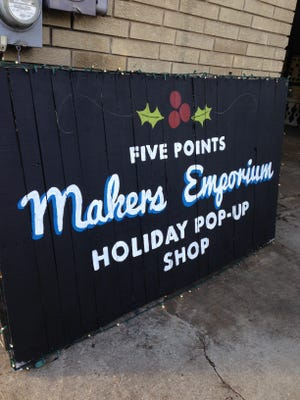 A sign outside the Five Points Makers Emporium Holiday Pop-Up Shop