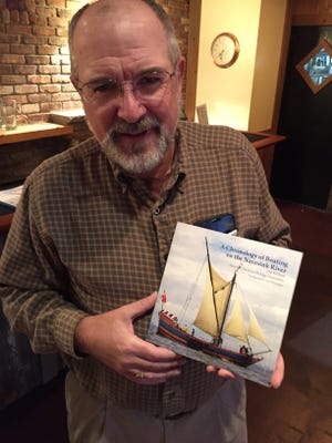 """Author Hendrik F. van Hemmen with the second edition of his book """"A Chronology of Boating on the Navesink River."""""""