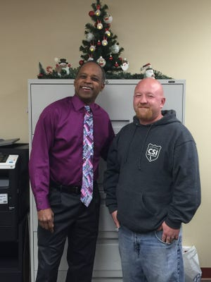 Eric Hale, a volunteer with Code Blue and an employee of CSI Cleaning Service, thanks Dr. Sydney L. Tyson MD and his staff for their support of Code Blue.