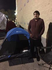 """Mike Ross stands outside the tent he'll be sleeping in Tuesday and Wednesday night as he camps out in front of Carmike Bayou 15 for Thursday's advance screening of """"Star Wars: The Force Awakens."""""""