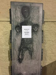 """An effigy of Han Solo (as played by Harrison Ford), frozen in Carbonite, heads the line in front of Carmike Bayou 15, as fans await the 7 p.m. Thursday debut of """"Star Wars: The Force Awakens."""""""