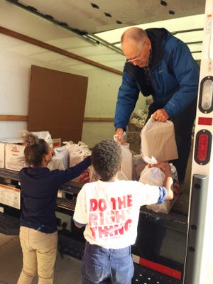 Green BEAN Delivery donated 504 pounds of fresh oranges to Childhood Food Solutions on Wednesday.