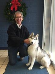 Chris Barnett poses with Kodi at the vet's office Wednesday.