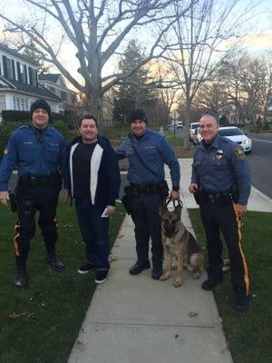 (Left to right): Deal Police Sgt. Brian Egan, Christian Pescatore, Patrolman Dan Lokerson, K-9 Atok and Patrolman Brad Kerney.