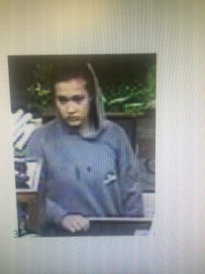 Police are searching for this woman, described as either Asian or mixed race, after she robbed the Origin Bank earlier Monday.