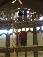 Crews disassemble the Nativity window at Trinity Episcopal Church in Asbury Park.
