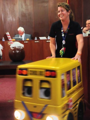 Murfreesboro City Schools bus driver Deidra Elliott wheels Barney the Bus Driver away after a presentation to the Murfreesboro City School Board in October 2015.