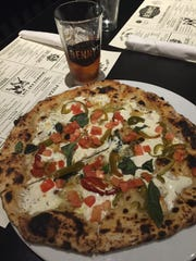 A signature pizza at Benny?s Fattoria in Belmar is the Fat Lip, topped with provolone, vinegar peppers and tomatoes.