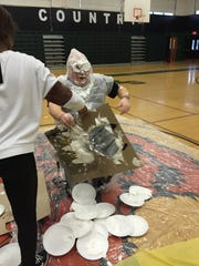 South Plainfield Middle School eighth grade History teacher Joe Blondo gets pied for a worthy cause.