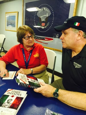 Author Christopher Kelly chats with Battleship New Jersey museum store director Donna Klees at a book signing. He is co-author of 'Italy Invades' and 'America Invades, both on sale in Camden. Some proceeds will benefit the ship.