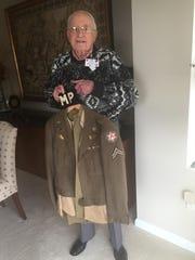 Fred Bernstein shows off his World War II uniform.