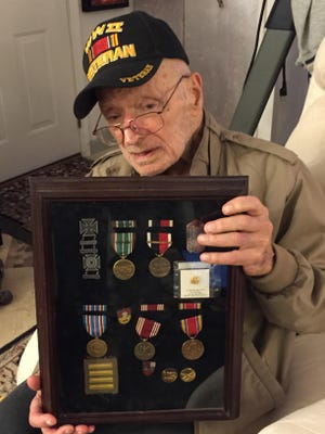Frank Buffone of Novi shows off some of his World War II medals.