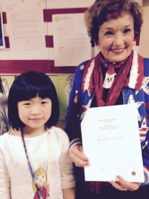 State Rep. Sheila Klinker, a Lafayette Democrat, visited Cumberland Elementary School in West Lafayette to talk about an effort to name the firefly the official state insect. She's joined by Kayla Xu, who helped lead the effort.