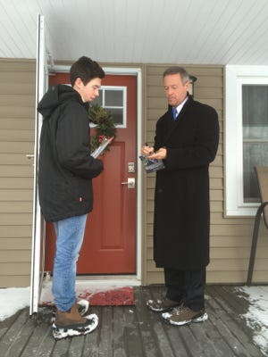 Martin O'Malley and his son, William, door-knock in Beaverdale on Wednesday afternoon.