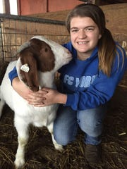 Lacey Walker, 15, of Codorus Township poses with her goat, Gabe. Gabe will be entered in the market goat competition at the 2016 Pennsylvania Farm Show.