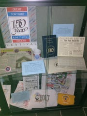 Historical items on display at Delhi Township Hall.