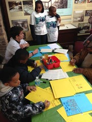 Children create art inspired by a reading of Martin