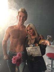 "Model Jon Brownell strikes a pose with Jax during the shooting of her music video for the new single ""La La Land."""