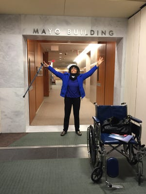 Murfreesboro City Councilwoman Madelyn Scales Harris praises the Lord in a hallway at the Mayo Clinic after several weeks of medical tests and  a doctor telling her she had autonomic nerve dysfunction.