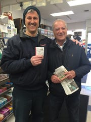 Lou Bertussi (left) and Carmelo Ritrovato buy lottery tickets in Pearl River.