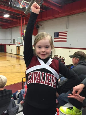Alayna Scallion is a 9-year-old cheerleader from Alamo Elementary who has become a junior member of her sister's team at Crockett Middle.