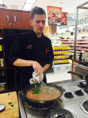 Chef Sean McMonagle stirs Swedish meatballs in a lIngonberry sauce during a recent culinary workshop at the Marlton ShopRite for a bargain cost of $20 per guest