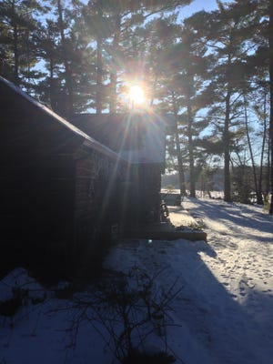 """Sun streams through the windows of the """"Church of the Pines."""""""