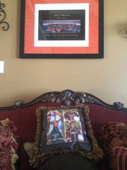 A pillow with pictures of Shawn and Keyshawn Collier rests under the twins' eighth-grade class picture in the Collier home.