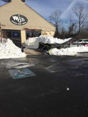 MJ's awning in Neptune fell during the weekend blizzard. The awning remains buried under several feet of snow.