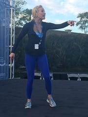 Fitness expert Sydney Benner  leads a morning warmup for guests of the Clinton Foundation's Health Matters Summit.