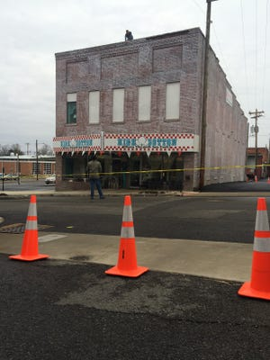 College Street between Main and Church streets was closed early Tuesday morning due to falling bricks.