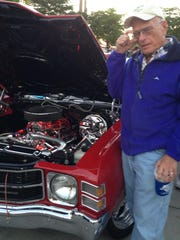 Ken Stocke answers questions about his 1971 Chevrolet Chevelle during the Caribbean Cruise-In Car Show.