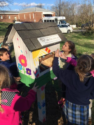 """Battle Ground Academy students install a """"Little Free Library"""" at the Hard Bargain neighborhood."""