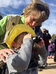 Birder Margaret Fahey, top, helps her grandson, Evan