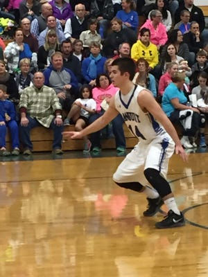 Danbury's Connor Lenthe plays defense Friday against Gibsonburg.