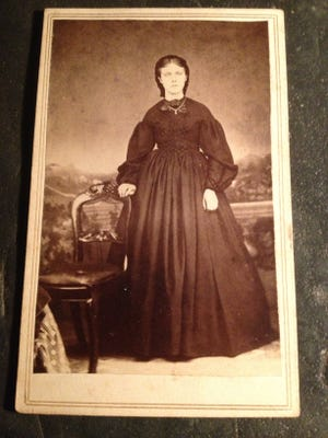 """A widow in full mourning, known as """"widow's weeds"""""""