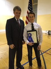Trey F. Houston of Bunkerville accepts an award from Nevada Assemblyman Chris Edwards at a recent 4-H event in Overton.