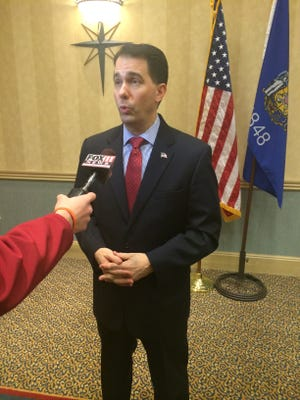 Gov. Scott Walker speaks to the media Friday afternoon following a speech at Blue Harbor Resort in Sheboygan.
