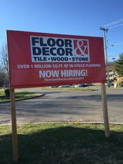 A sign announces that Floor & Decor also is coming to the former Target building.