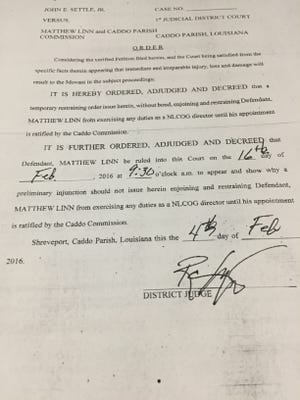A temporary restraining order has been placed against Commissioner Matthew Linn from acting as NLCOG director.