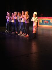 Several of the students work on the first scene in Willy Wonka Junior at the Brighton Center of Performing Arts.