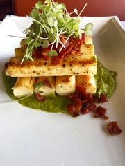 Chef Jeff Acol of A Table Apart in Bonita Springs created this dish featuring hearts of palm and a fresh collard puree.