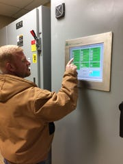 Brooks Boyett, Plant Shift Supervisor, is using the Human Machine Interface (HMI) to determine the lime dosage used in the softening process that aids with the corrosion control program.