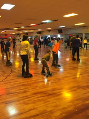 Skaters of all ages and abilities take to the beechwood floor of the Florham Park Roller Skating Rink.