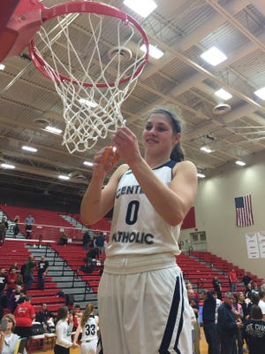 Central Catholic senior Cameron Onken cuts down the net after leading the Knights past Oregon-Davis 75-63 Saturday.