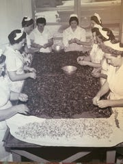 Employees are pictured peeling crawfish for Don's Seafood and Steakhouse in this 1940s photo.