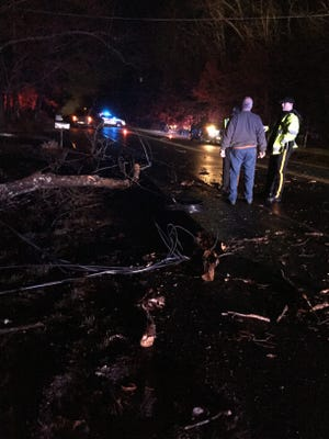 Two women were trapped in a vehicle caught in a tangle of wires on Wednesday night on Mays Landing Road in Vineland. The wires fell during a severe round of storms that swept through the area.