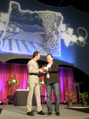 Oregon Wine Board Director Juan Pablo Valot, left, presents Efren Loeza of Willamette Valley Vineyards with the Vineyard Excellence Award.