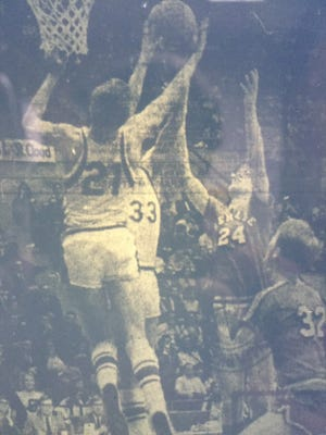 St. Cloud Cathedral clashes with St. Louis Park Benilde in the 1969 state Catholic school championship game in Minneapolis.